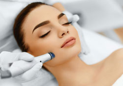 Woman receiving facial medispa treatment in Sedona spa